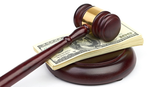 Judge's gavel with a stack of cash
