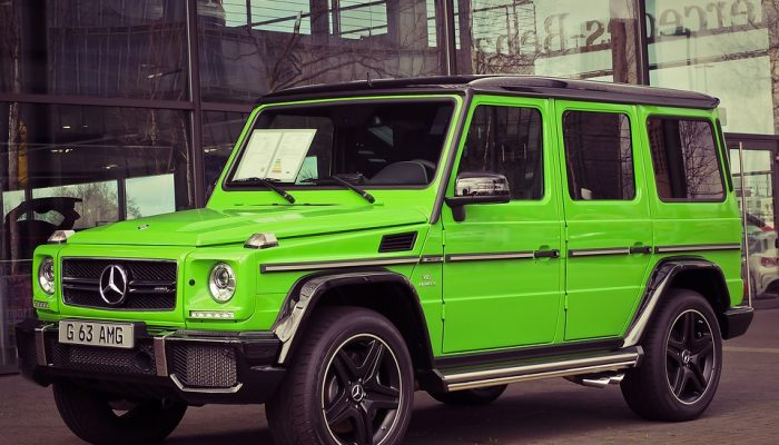 Car dealers can often sell colorful used cars like this bright green vehicle for more