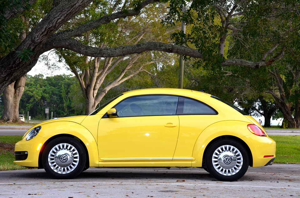 Small Used Car Sales Rising - Yellow Compact Car