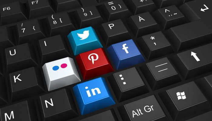 Social media icons on keyboard - social media BHPH Dealership Marketing