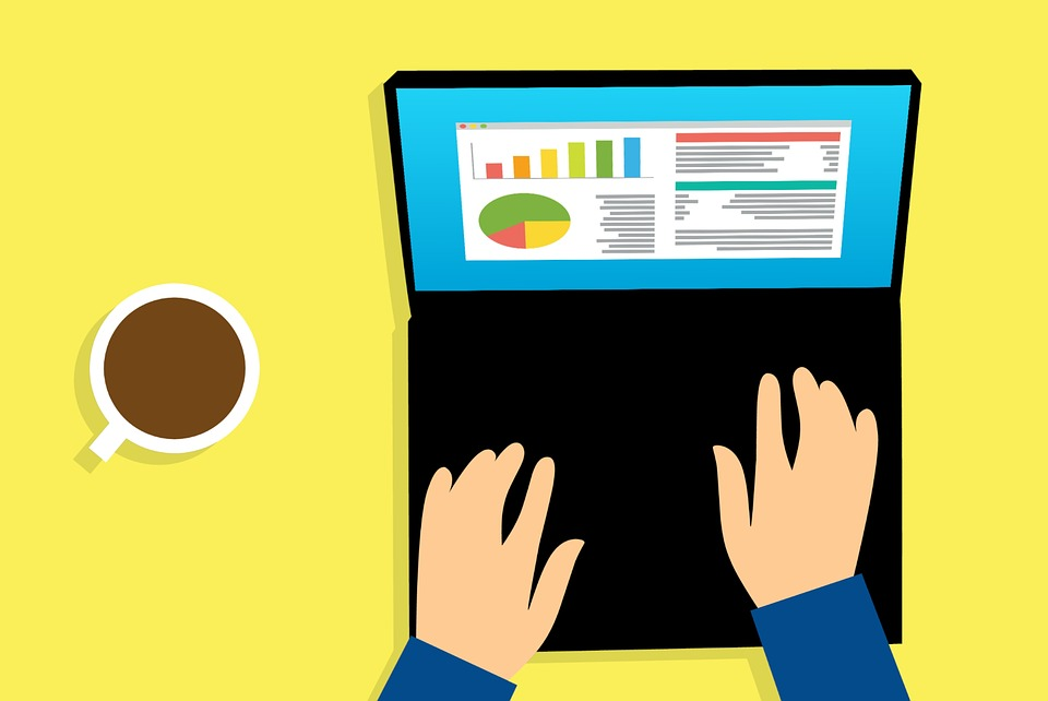 Google Analytics on Laptop Screen with Hand Typing and Coffee Cup on the Left