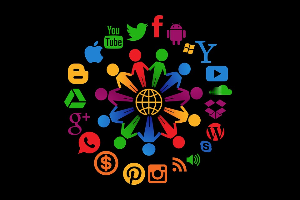 Video SEO - Circle of colorful figures surrounded by various video and social media website icons